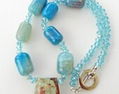 Bold crackled turquoise glass beads with brown and cream swirl marblized pendant necklace