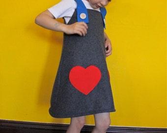 Girls dress jumper with heart pockets.