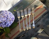 Eat in style,matching silver forks  feature in TREASURES