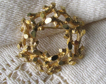 Golden metal brooch