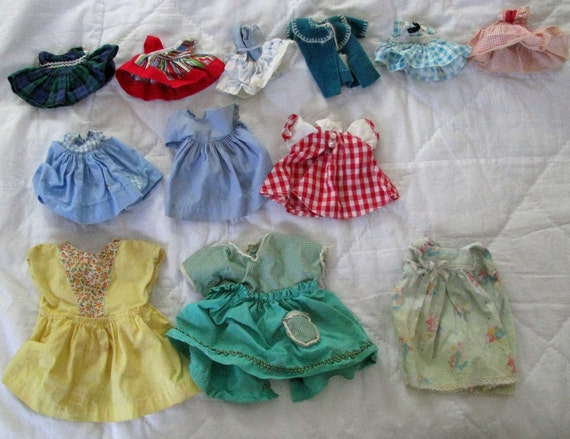 Bag of doll clothes and shoes