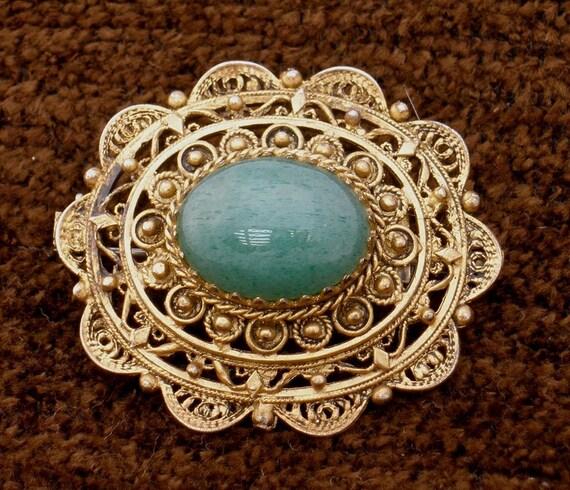 1970s Faux Jade Gold Tone Metal Filigree Brooch Pin