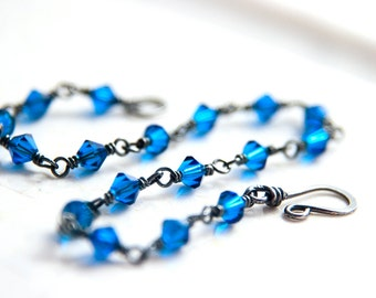 Blue and Gunmetal Bracelet Sterling Silver Swarovski Crystal Bracelet Electric Capri Blue Oxidized Black Metal Wire Wrapped