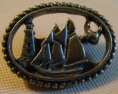 Pewter, I believe, Brooch or Pin with a Lighthouse and Ship