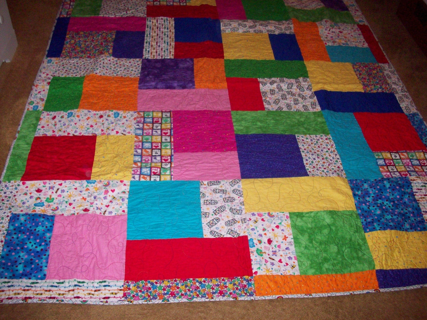 Brightly colored turning twenty quilt