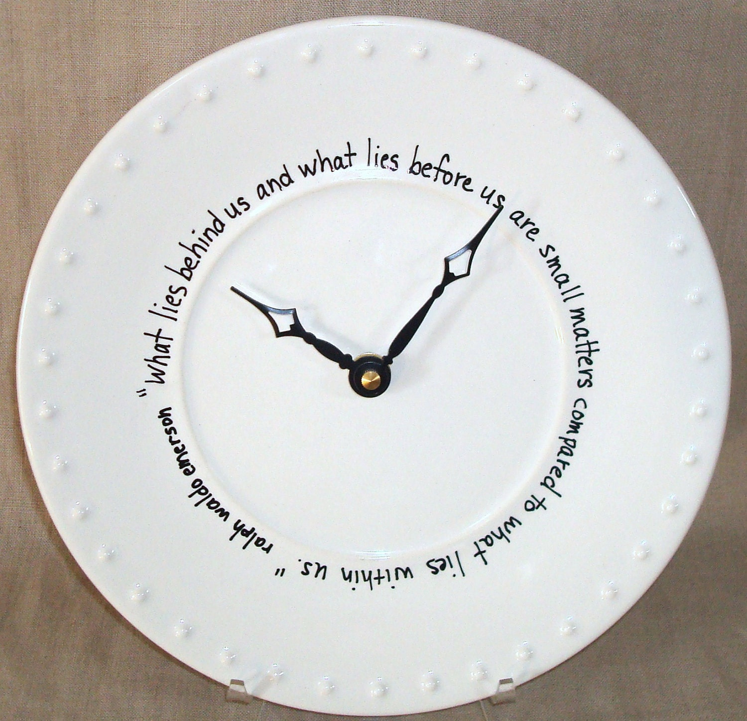 On Sale Wall Clock Black And White Quote What Lies Behind