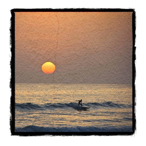 Surfing at sunset. Mixed media print and photography.