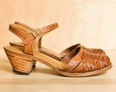 1970's wood sandals. Woven tan leather with small stacked heels. Size 5.