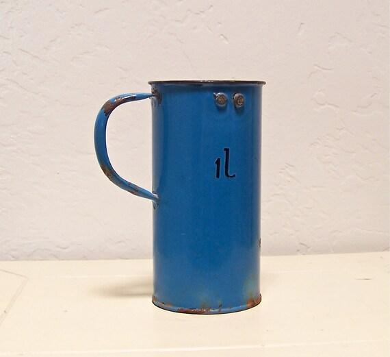 50% off vintage Hungarian blue enamel cup