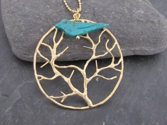 Bird in the tree in gold (N99)