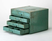 Reserved do not buy  Vintage Industrial Green Parts cabinet..