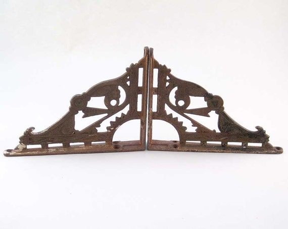 Vintage Architectural iron shelf supports decorative elements