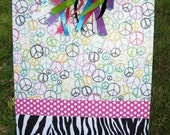 Altered clipboard decorated with brightly colored PEACE signs and ZEBRA stripes