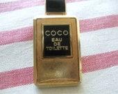 Authentic Chanel coco eau de toilette pin tie back Fun and cute