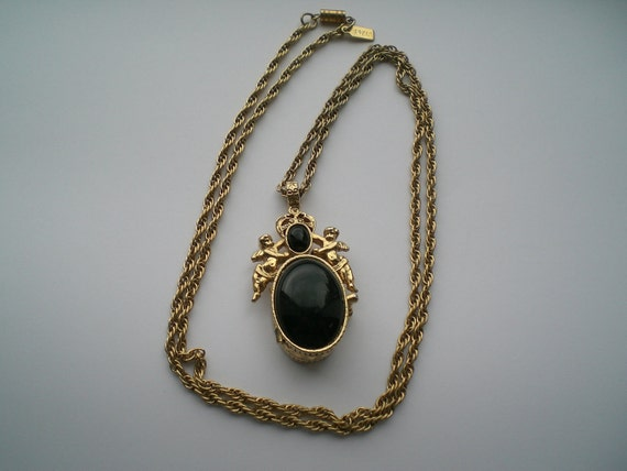 Cherib Locket with Goldtone Metal and Chain Large Black Faux Cabochon on Top of Box signed 1928 Jewelry Company