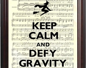 Keep calm and defy gravity print Keep calm and carry on Poster  on old music sheet reproduction