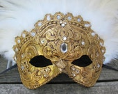 Ornate gold Venetian mask with white feathers, Dalliance
