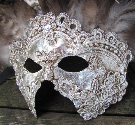 Venetian masquerade mask in ornate silver with brown feathers, Rey