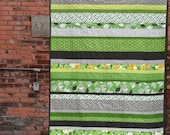 Signs of Spring - a Flea Market Fancy strip quilt in green