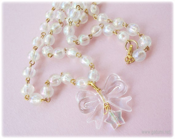 Ice Fairy Beaded Iridescent Bow Necklace with Star Charm