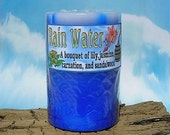 Rain Water scented, 3 inch diameter X 4 1\/2 inch tall, pillar candle, streaked royal blue with a light blue top, OWS Team