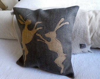 hand printed rustic hessian hare cushion cover