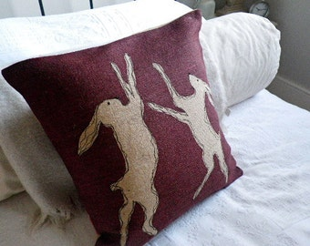 limited addition rustic burgundy boxing hares cushion cover