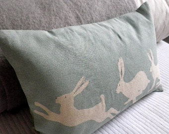 Hand printed duck egg triptyque hares cushion cover