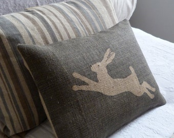 hand printed and stitched charcoal leaping  hare  cushion