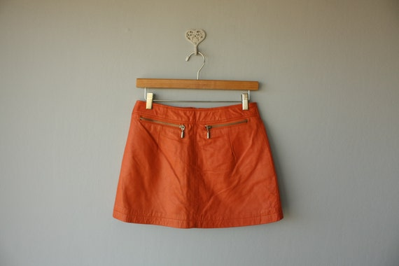 1980s vintage leather mini skirt // orange leather skirt