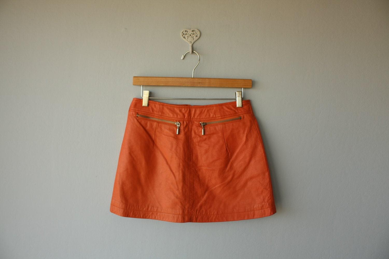 1980s vintage leather mini skirt // orange leather skirt