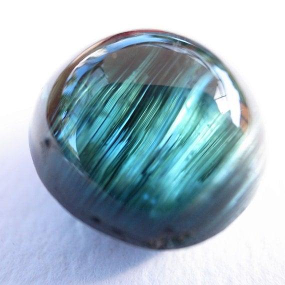 23.5ct tourmaline catseye, stunning blue-green
