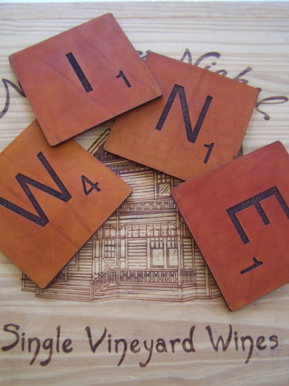 Scrabble letters spell wine on handmade leather coasters