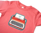 The TYPEWRITER Tee - in Pomegranate on an Unisex American Apparel Organic Cotton Tee