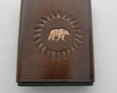 Custom bear leather flask.