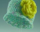 Item 16 -  Crocheted Baby Hat in Turquoise with different color Flecks and Yellow Rose