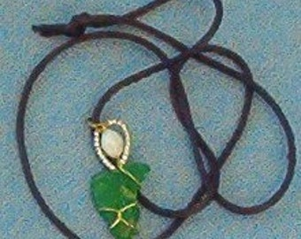 Green heart shaped Hawaiian beach glass pendant on cord