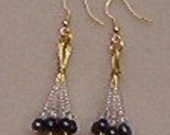 Handmade fresh water pearl dangle earrings strung on gold color wire with clear seed beads