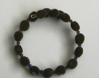 Hawaiian mgambo seed and amethyst 2AB or AB2X Swarovski 4mm bicone crystal bracelet