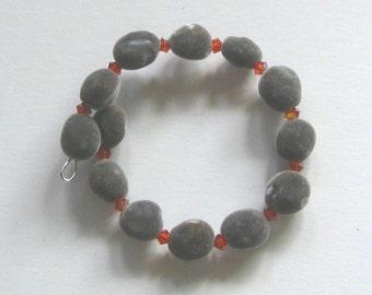 Hawaiian mgambo seed and Indian Red AB Swarovski crystal bracelet, handmade in Hilo, Hawaii