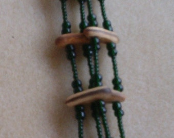 """4 Strand Necklace - Dark olivine green Ornela seed beads, Royal Poinciana seed spacer bars, 30"""" long"""