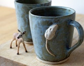 Two stoneware pottery coffee mugs - glazed in smokey blue with tiny mouse