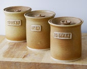 Set of three tea, coffee and sugar jars - stoneware pottery canisters in natural brown