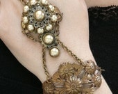 Theda .. Vintage Pearl and Filigree Brass Handflower Gypsy Bracelet