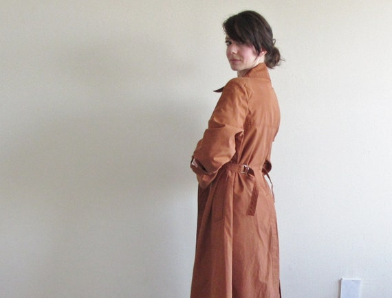 r e s e r v e d burnt tan rust trenchcoat . 1970 fitted trench dress .small.medium .sale