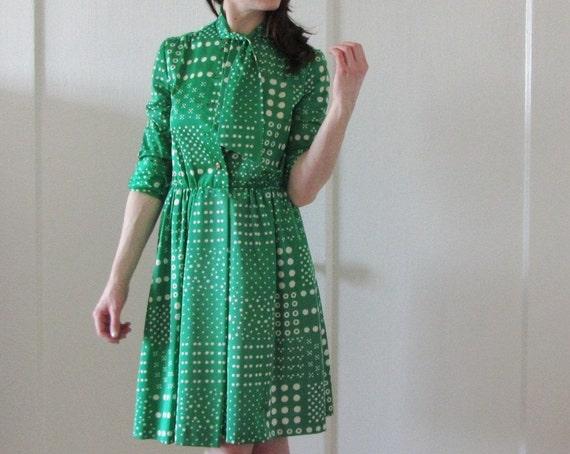 grass green 1970 secretary dress . polka dots and ascot necktie .small.medium .sale