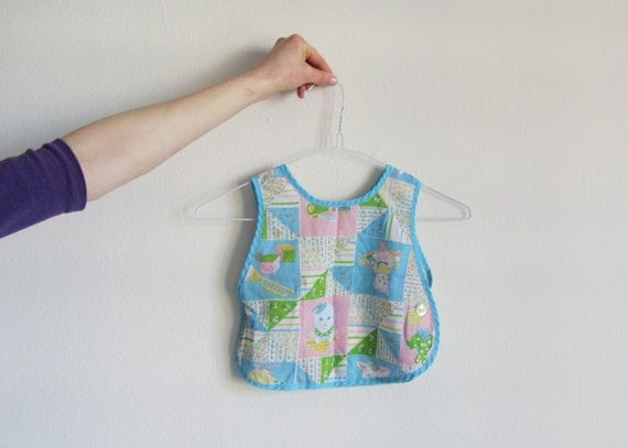 mother goose bib smock . story time pastel baby wear .sale s a l e .disaster relief