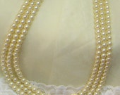 Vintage Avon gold tone butterfly with rhinestones faux Pearl necklace