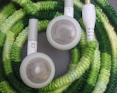 Earbuds wrapped in lime forest green