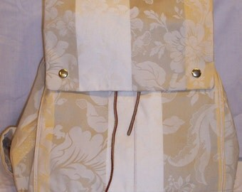 Clara Backpack in Taupe, Gold, and Cream Striped Silk with a Magnolia Blossom Pattern and a cream linen lining